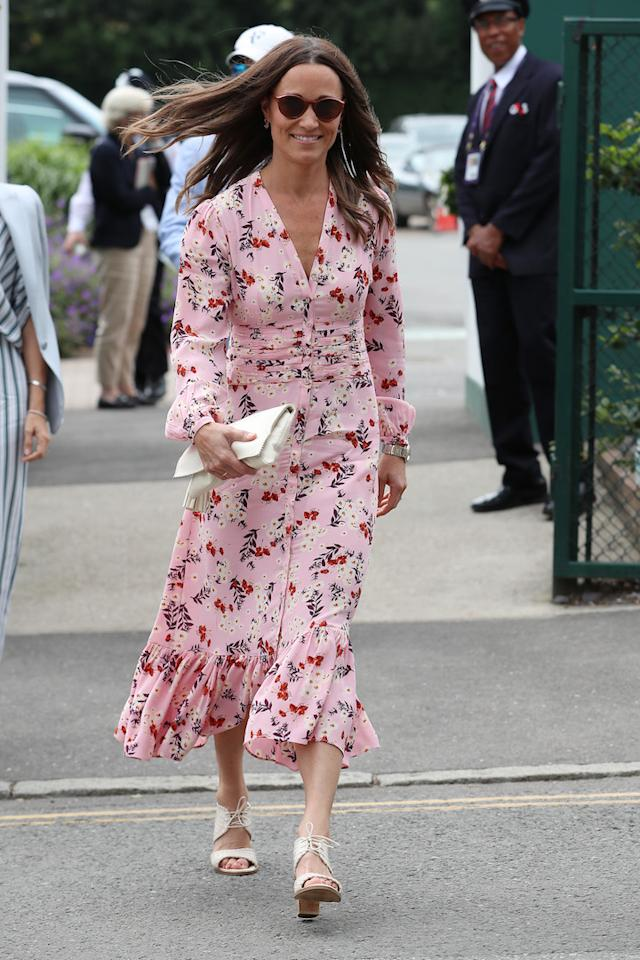 "For her final fashion outing at Wimbledon, Pippa chose a floral dress by Norwegian brand byTiMo. The midi dress promptly sold out online but a <a href=""https://www.bytimo.no/product/bloom-flared-gown/"">similar look</a> in the same print is still available to shop. <em>[Photo: Getty]</em>"