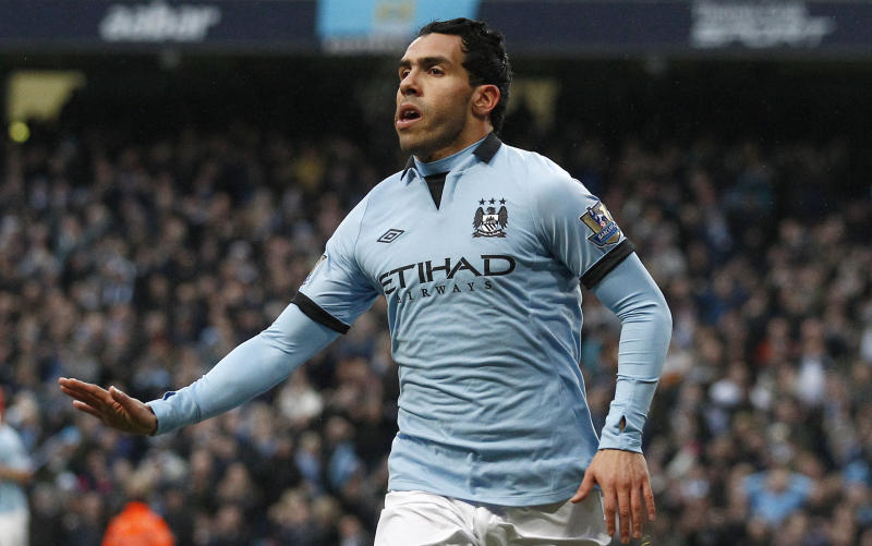 Manchester City's Carlos Tevez celebrates after scoring against Barnsley during their English FA Cup quarterfinal soccer match at The City of Manchester Stadium, Manchester, England, Saturday, March 9, 2013. (AP Photo/Jon Super)