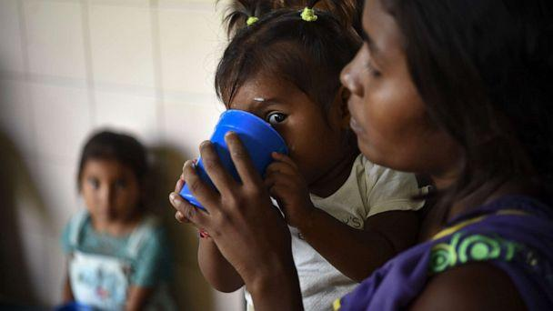 PHOTO: Yukpa indigenous children, some of them suffering from malnutrition, are fed with supplements provided by CARITAS organization, at Los Angeles del Tukuko mission, near Machiques, Zulia state, Venezuela, July 5, 2019. (Yuri Cortez/AFP/Getty Images, FILE)