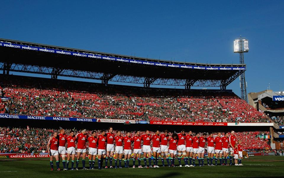 The Lions line up for the anthems behind a sea of red - GETTY IMAGES