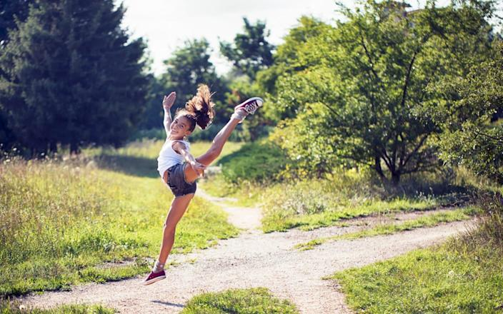 Girl exercising - Getty