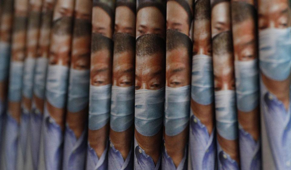 Copies of the Apple Daily newspaper with front pages featuring Hong Kong media tycoon Jimmy Lai are displayed at a news-stand following Lai's arrest. Photo: AP