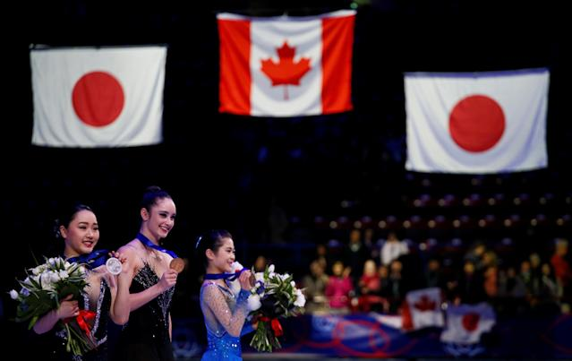 Figure Skating - World Figure Skating Championships - The Mediolanum Forum, Milan, Italy - March 23, 2018 Canada's Kaetlyn Osmond poses with the gold medal as Japan's Wakaba Higuchi and Satoko Miyahara pose with their respective silver and bronze medals after the Ladies Free Skating REUTERS/Alessandro Garofalo