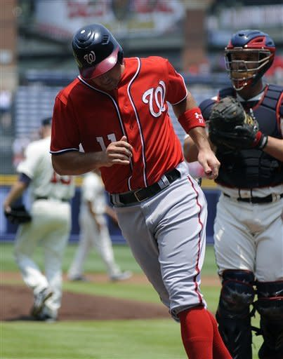 Washington Nationals' Ryan Zimmerman (11) scores in front of Atlanta Braves catcher David Ross in the first inning of their baseball game on Sunday, July 1, 2012, at Turner Field in Atlanta. (AP Photo/David Tulis)
