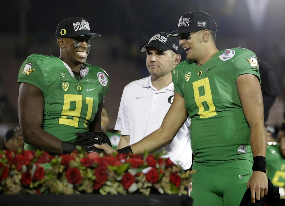 Oregon quarterback Marcus Mariota, right, celebrates with linebacker Tony Washington, left, and head coach Mark Helfrich celebrate after a 59-20 win over Florida State during the second half of the Rose Bowl NCAA college football playoff semifinal, Thursday, Jan. 1, 2015, in Pasadena, Calif. (AP Photo/Jae C. Hong)