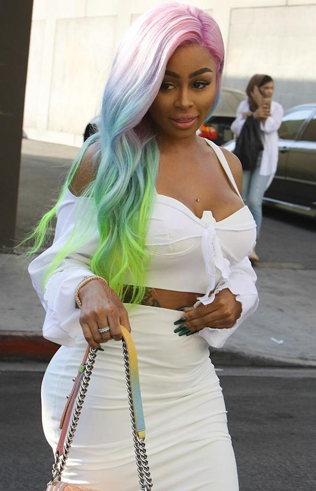 "<p>What drama? Chyna was <i>so</i> over her <a href=""https://www.yahoo.com/celebrity/rob-kardashians-instagram-gets-shut-blac-chyna-rants-211416989.html"" data-ylk=""slk:feud with Rob Kardashian;outcm:mb_qualified_link;_E:mb_qualified_link"" class=""link rapid-noclick-resp newsroom-embed-article"">feud with Rob Kardashian</a> as she rocked <a href=""https://www.yahoo.com/celebrity/blac-chyna-makes-colorful-public-035500458.html"" data-ylk=""slk:rainbow tresses;outcm:mb_qualified_link;_E:mb_qualified_link"" class=""link rapid-noclick-resp newsroom-embed-article"">rainbow tresses</a> at a photo shoot in L.A. (Photo: LESE/BACKGRID) </p>"