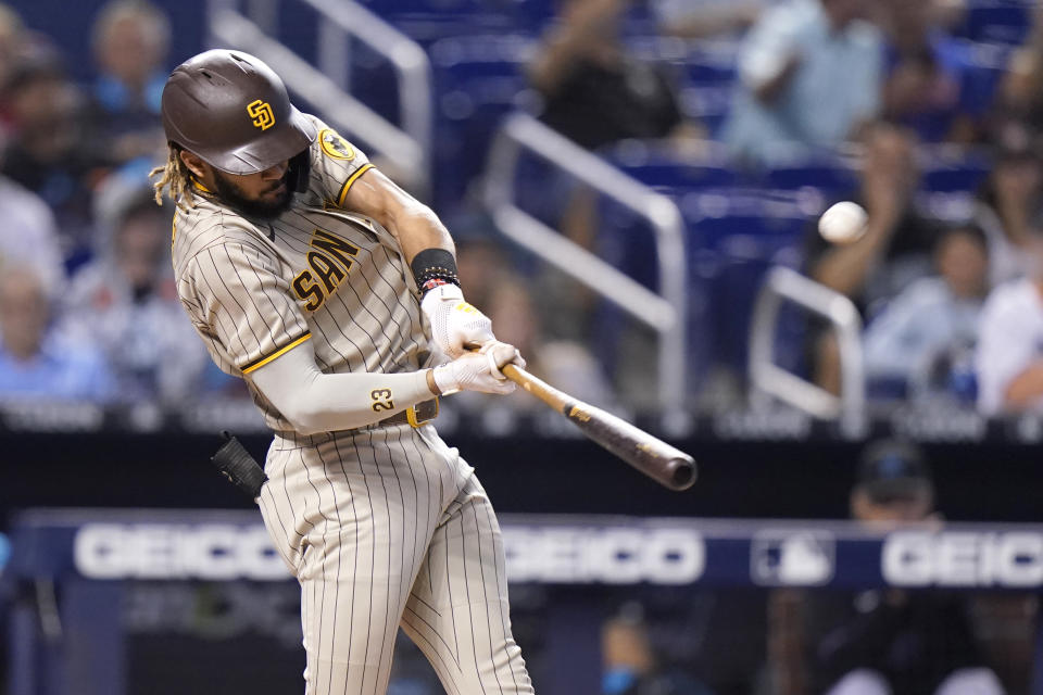 San Diego Padres' Fernando Tatis Jr. hits a solo home run during the first inning of a baseball game against the Miami Marlins, Saturday, July 24, 2021, in Miami. (AP Photo/Lynne Sladky)