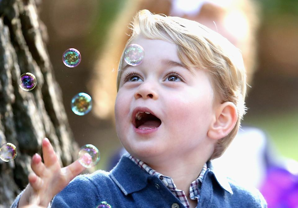 VICTORIA, BC - SEPTEMBER 29:  Prince George of Cambridge plays with bubbles at a children's party for Military families during the Royal Tour of Canada on September 29, 2016 in Victoria, Canada. Prince William, Duke of Cambridge, Catherine, Duchess of Cambridge, Prince George and Princess Charlotte are visiting Canada as part of an eight day visit to the country taking in areas such as Bella Bella, Whitehorse and Kelowna  (Photo by Chris Jackson - Pool/Getty Images)