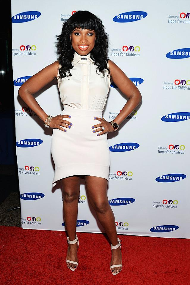 Weight Watchers is working for Jennifer Hudson, and so is this Givenchy getup she wore to the annual Hope for Children gala at New York's American Museum of Natural History. Are you fond of her pale peach silk top, jersey knit skirt, and ankle strap sandals? What about those bangin' bangs? (6/4/2012)