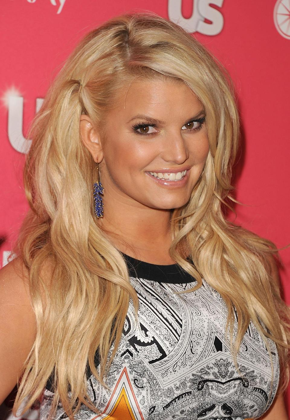 "<b>Jessica Simpson:</b> ""Praying for the victims and families of those involved in the shooting in Colorado. My heart is broken. So awful. God Bless... "" (Photo by Jason Merritt/Getty Images)"