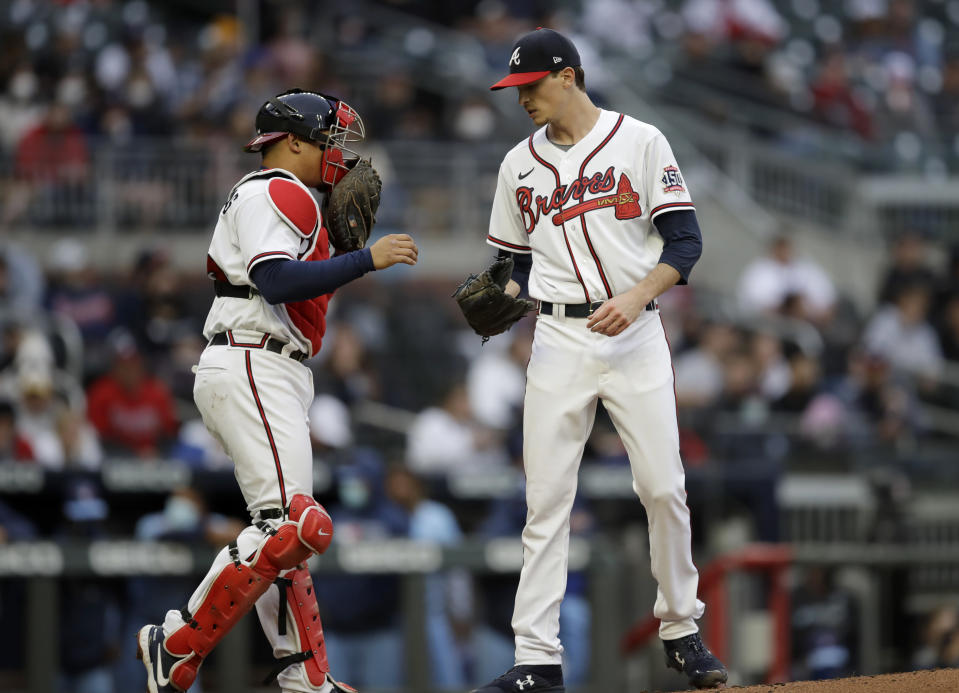 Atlanta Braves pitcher Max Fried, right, speaks with catcher William Contreras during the first inning of the team's baseball game against the Toronto Blue Jays on Wednesday, May 12, 2021, in Atlanta. (AP Photo/Ben Margot)