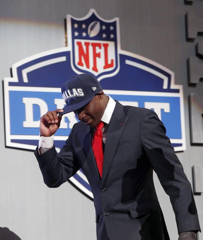 LSU cornerback Morris Claiborne walks on stage after being selected as the sixth pick overall by the Dallas Cowboys in the first round of the NFL football draft at Radio City Music Hall, Thursday, April 26, 2012, in New York. (AP Photo/Jason DeCrow)