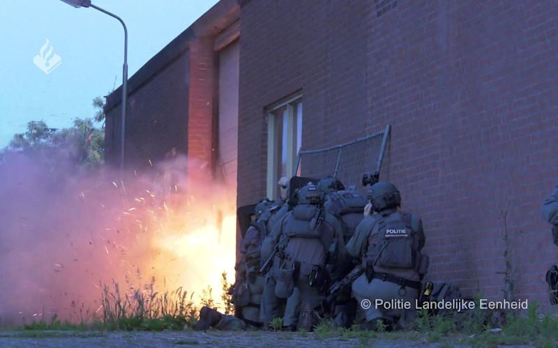 Dutch police uses explosives to enter a building where a torture chamber is hidden in a shipping container - REUTERS