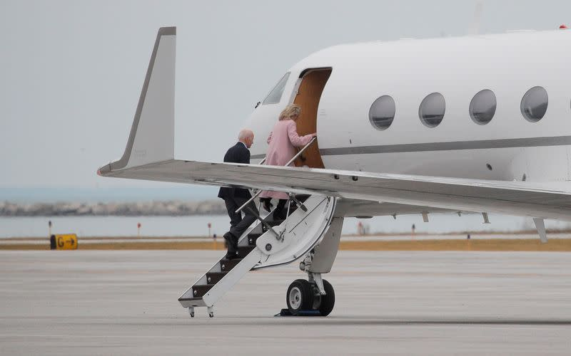 Democratic U.S. presidential candidate and former Vice President Joe Biden reboards his campaign plane shortly after arriving in Cleveland to depart after canceling rally over coronavirus concerns in Cleveland, Ohio
