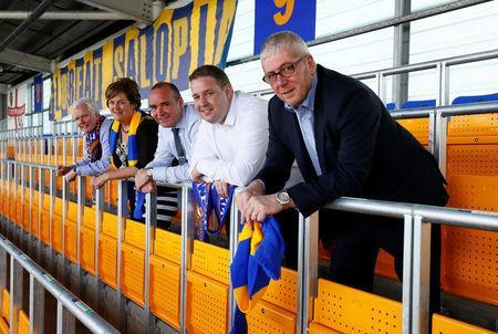 Soccer Football - League One - Shrewsbury Town Safe Standing Press Launch - Montgomery Waters Meadow, Shrewsbury, Britain - May 22, 2018 Supporters Parliament chairman Roger Groves, Mike Davis, Ferco Seating Systems Managing Director Michael Burnett, Shrewsbury Town CEO Brian Caldwell and Mayor of Shrewsbury Jane MacKenzie during the Press Launch Action Images/Jason Cairnduff