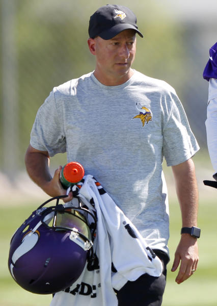 """FILE - In this July, 29, 2016, file photo, Minnesota Vikings trainer Eric Sugarman walks off the field during the first day of the NFL football team's training camp at Mankato State University in Mankato, Minn. Documents unsealed in a lawsuit by 1,800 former NFL players provide a behind-the-scenes glimpse at how team and league medical personnel distributed powerful painkillers to players. According to a Jan. 17, 2008 e-mail from Sugarman to team doctors and medical personnel, that was unsealed Friday, March 10, 2017, medications like Ambien, a sedative, and Toradol, a post-surgical painkiller, were distributed to players and not accurately tracked by the team's dispensing records. An NFL spokesman said, """"clubs and their medical staffs are all in compliance with the Controlled Substances Act. ... Any claim or suggestion to the contrary is simply wrong."""" (AP Photo/Andy Clayton-King, File)"""
