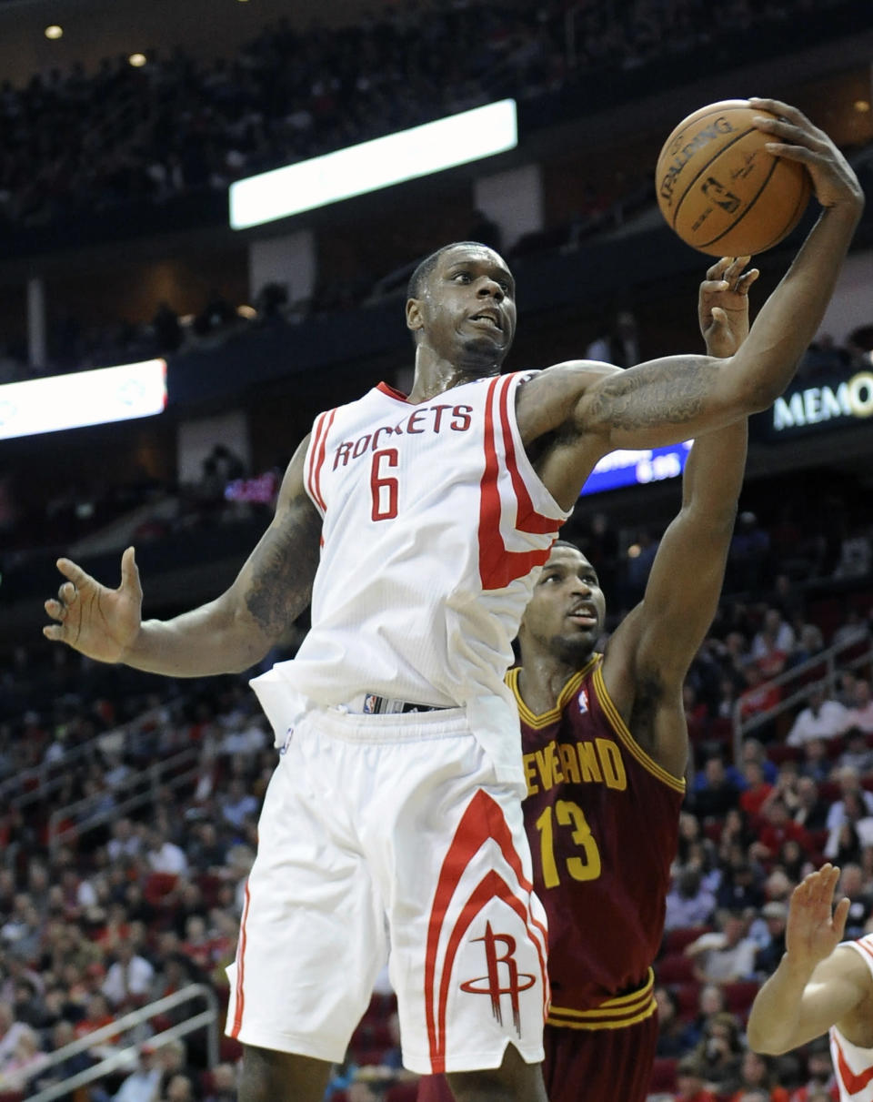 Houston Rockets' Terrence Jones (6) grabs a rebound ahead of Cleveland Cavaliers' Tristan Thompson (13) in the first half of an NBA basketball game Saturday, Feb. 1, 2014, in Houston. (AP Photo/Pat Sullivan)