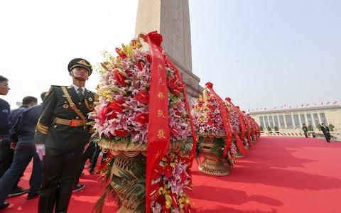 <span>Flower baskets have been presented to deceased national heroes</span> <span>Credit: VCG/VCG via Getty Images </span>