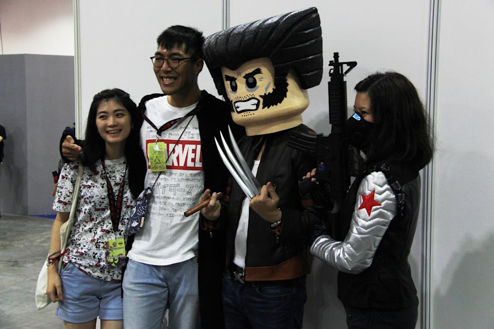 <p>Fans taking a photo with Lego cosplayers at the Singapore Toy, Game and Comic Convention (STGCC) 2018 (PHOTO: Abdul Rahman Azhari/Yahoo Lifestyle Singapore) </p>