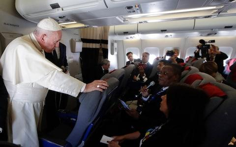 <span>Pope Francis answered questions from journalists while travelling back from a trip to Africa</span> <span>Credit: ALESSANDRA TARANTINO/ AFP </span>