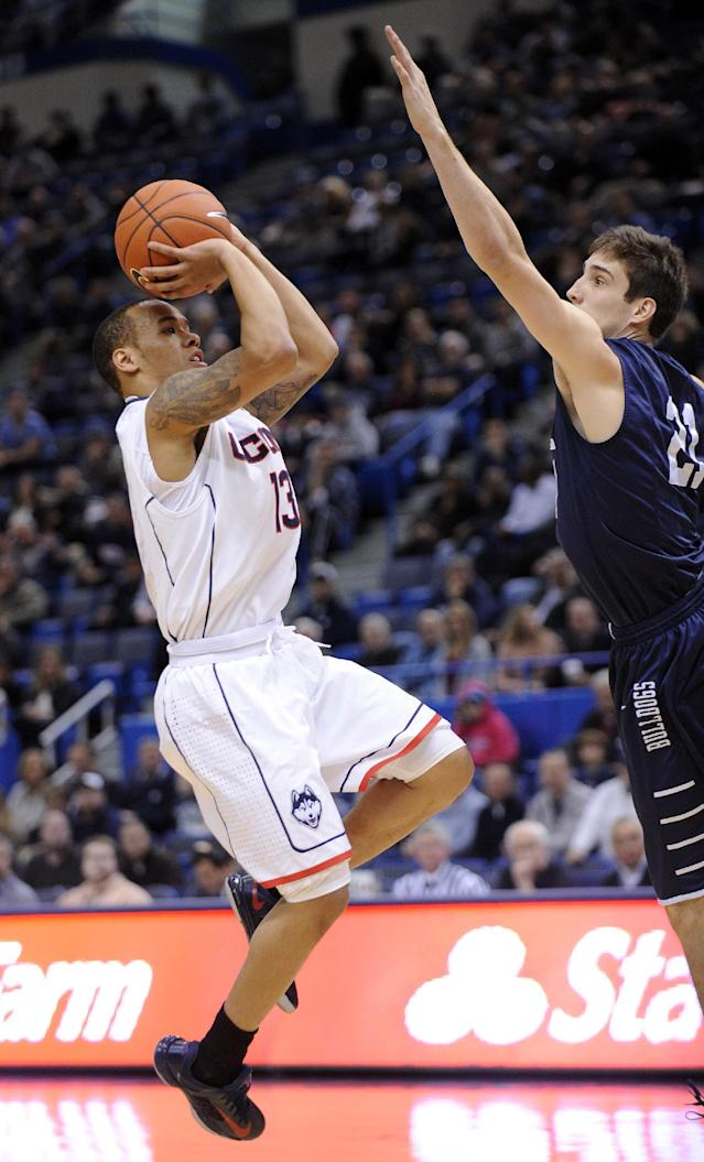 Connecticut's Shabazz Napier (13) shoots over Yale's Nick Victor (21) during the first half of an NCAA college basketball game, in Hartford, Conn., on Monday, Nov. 11, 2013. (AP Photo/Fred Beckham)