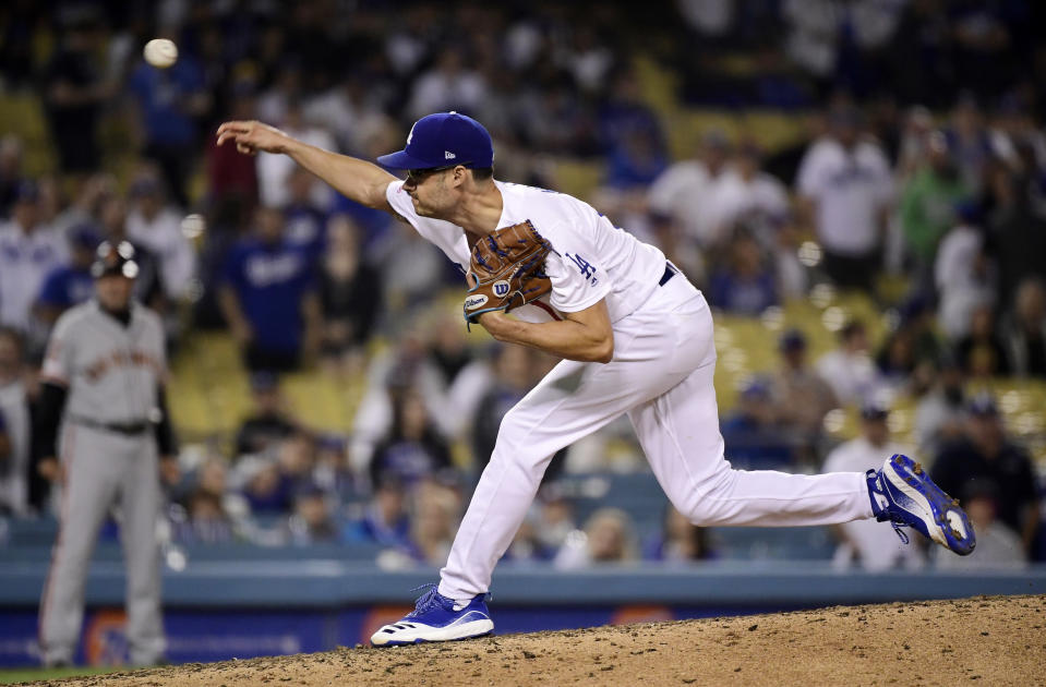 Los Angeles Dodgers relief pitcher Joe Kelly throws during the ninth inning of the team's baseball game against the San Francisco Giants on Tuesday, June 18, 2019, in Los Angeles. (AP Photo/Mark J. Terrill)