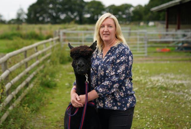 Geronimo the alpaca previously pictured with owner Helen Macdonald (Andrew Matthews/PA)