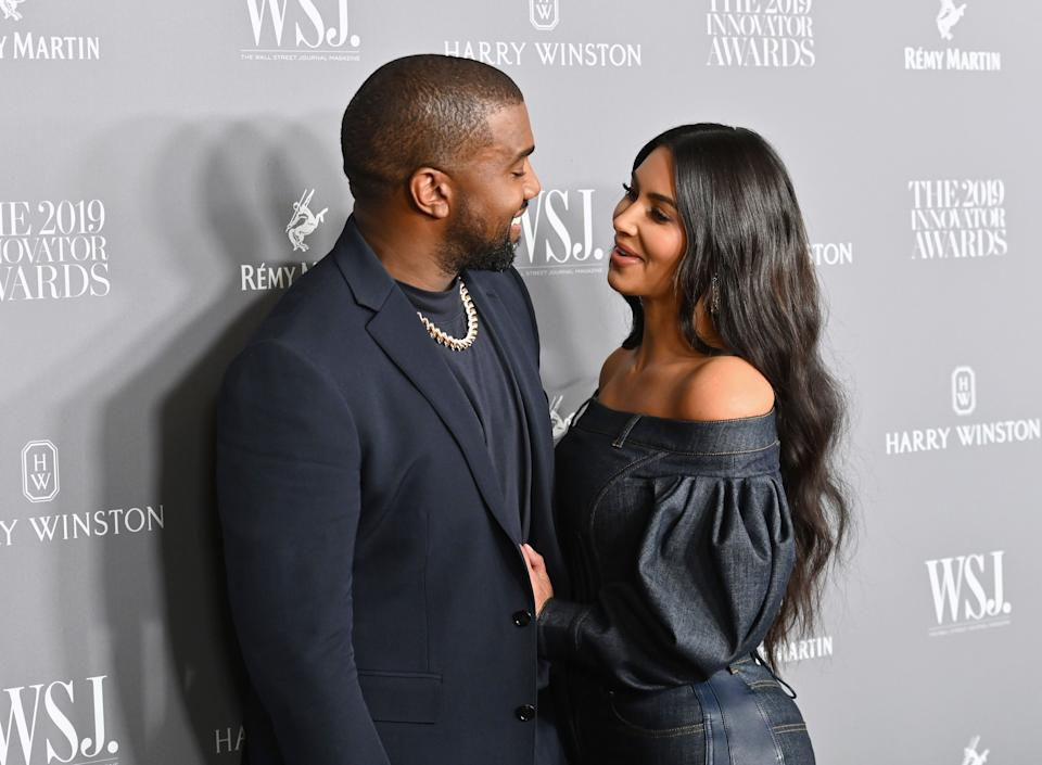 Kim Kardashian West (R) and husband US rapper Kanye West