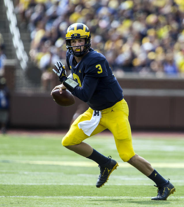 Michigan quarterback Wilton Speight (3) scrambles with the ball in the second quarter of an NCAA college football game against Air Force in Ann Arbor, Mich., Saturday, Sept. 16, 2017. (AP Photo/Tony Ding)