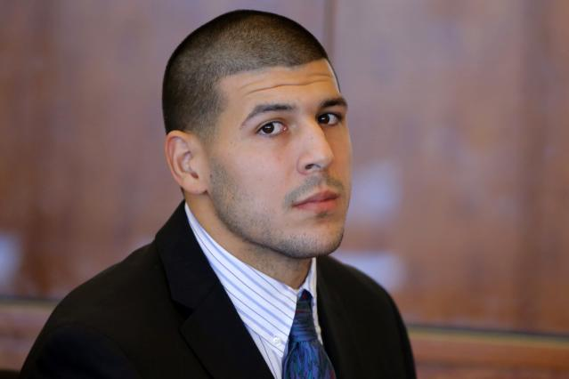 Aaron Hernandez, former player for the NFL's New England Patriots football team, attends a pre-trial hearing at the Bristol County Superior Court in Fall River, Massachusetts October 9, 2013, in connection with the death of semi-pro football player Odin Lloyd in June. Hernandez, who was a rising star in the NFL before his arrest and release by the Patriots, has pleaded not guilty. REUTERS/Brian Snyder (UNITED STATES - Tags: CRIME LAW SPORT FOOTBALL HEADSHOT)