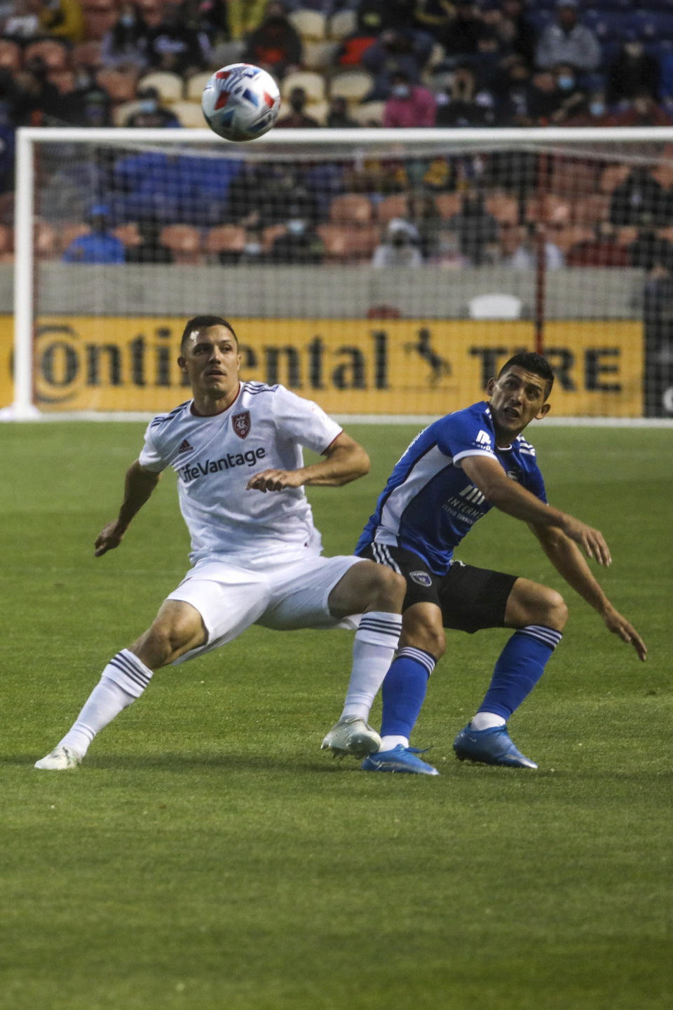 Real Salt Lake defender Donny Toia (4) fights for the ball with San Jose Earthquake midfielder Cristian Espinoza (10) during an MLS soccer match at Rio Tinto Stadium in Sandy, Utah, Friday, May 7, 2021. (Annie Barker/The Deseret News via AP)