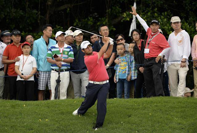 In this photo released by OneAsia, Alexander Levy of France watches his shot during the third round of the Volvo China Open at Genzon Golf Club in Shenzhen, southern China, Saturday, April 26, 2014. (AP Photo/OneAsia, Paul Lakatos)