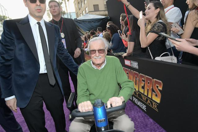"<p><a href=""https://www.yahoo.com/entertainment/stan-lee-accused-sexual-misconduct-massage-therapist-lawsuit-213330980.html"" data-ylk=""slk:Despite his latest offscreen drama;outcm:mb_qualified_link;_E:mb_qualified_link"" class=""link rapid-noclick-resp newsroom-embed-article"">Despite his latest offscreen drama</a>, the Marvel mastermind zipped in for the big event. (Photo: Charley Gallay/Getty Images for Disney) </p>"