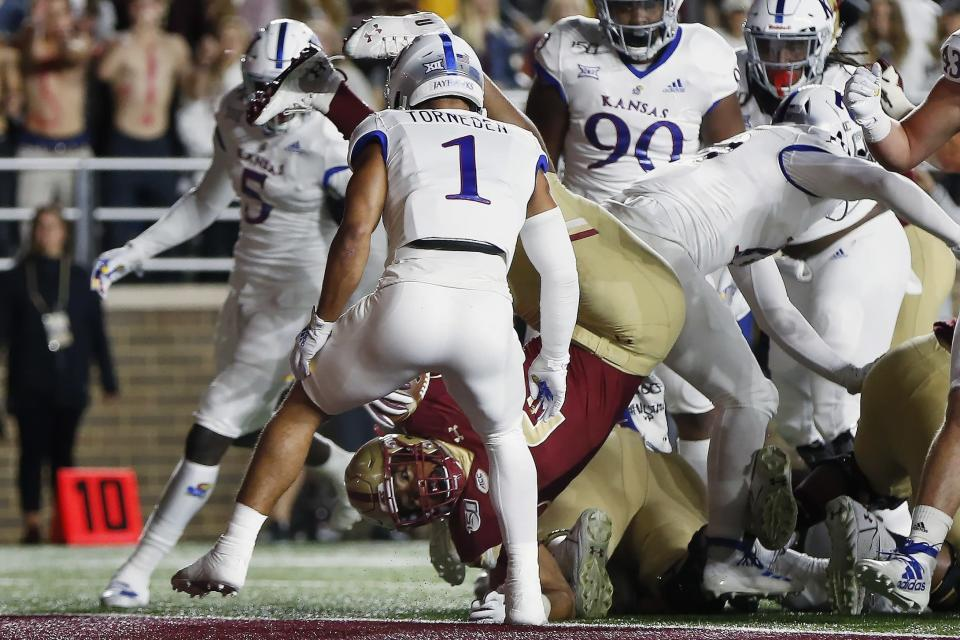 Boston College running back AJ Dillon scores in front of Kansas safety Bryce Torneden (1) during the first half of an NCAA college football game in Boston, Friday, Sept. 13, 2019. (AP Photo/Michael Dwyer)