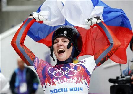 Russia's Elena Nikitina celebrates after competing in the women's skeleton event at the 2014 Sochi Winter Olympics