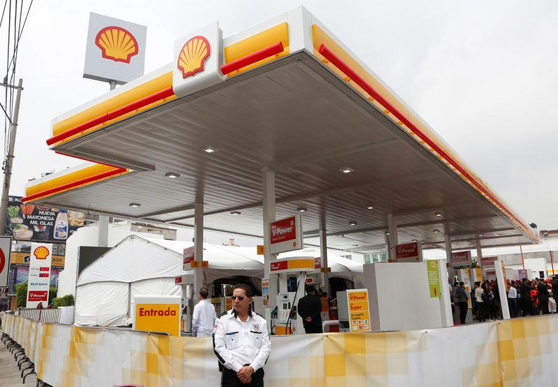 A guard stands outside Anglo-Dutch oil major Royal Dutch Shell's first gas station in Mexico City