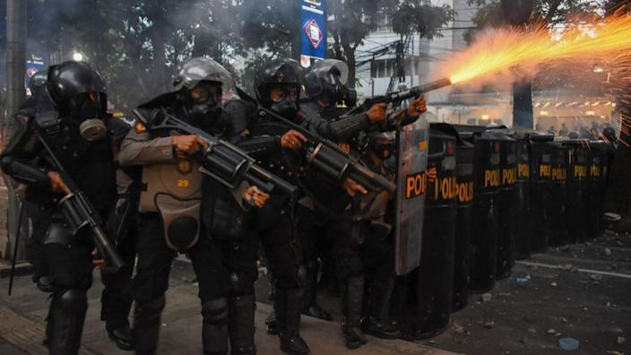 Indonesian riot police dispersed protestors with tear gas in the city of Bandung on Wednesday