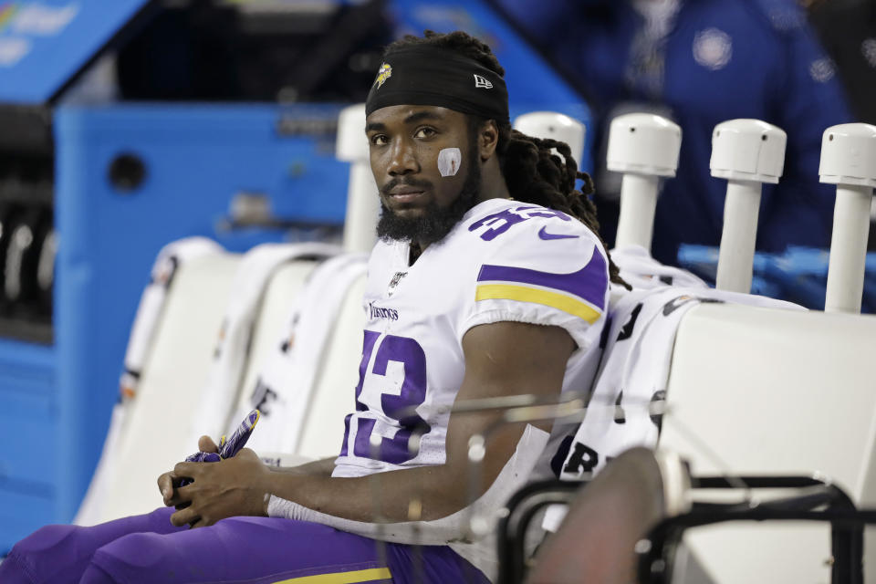 Minnesota Vikings running back Dalvin Cook has threatened to hold out without a new deal. (AP Photo/John Froschauer)