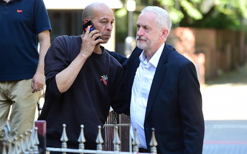 Jeremy Corbyn speaks to locals in Finsbury Park - Credit: Geoff Pugh for The Telegraph