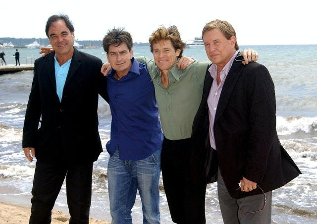 Oliver Stone with the stars of Platoon, Charlie Sheen, Willem Dafoe and Tom Berenger (Anthony Harvey/PA)