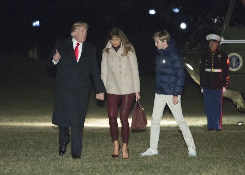 She held onto her husband, Donald Trump's, hand as she walked across the lawn with her son, Barron Trump. Photo: Getty Images