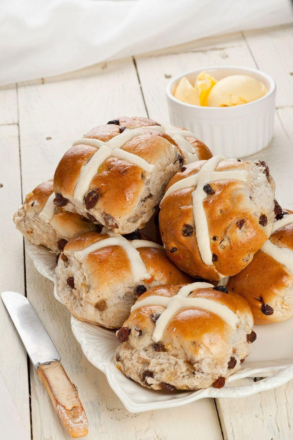 """<p>This simple hot cross bun recipe will become a family favorite year after year.</p><p><em><a href=""""https://www.womansday.com/food-recipes/food-drinks/recipes/a21048/hot-cross-buns-3699/"""" rel=""""nofollow noopener"""" target=""""_blank"""" data-ylk=""""slk:Get the Hot Cross Buns recipe"""" class=""""link rapid-noclick-resp""""><strong>Get the Hot Cross Buns recipe</strong></a><strong><strong>. </strong></strong></em><br></p>"""