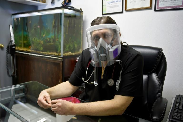 Alberto Landetta, a 53-year-old doctor, now always keeps a mask, face shield and gloves nearby