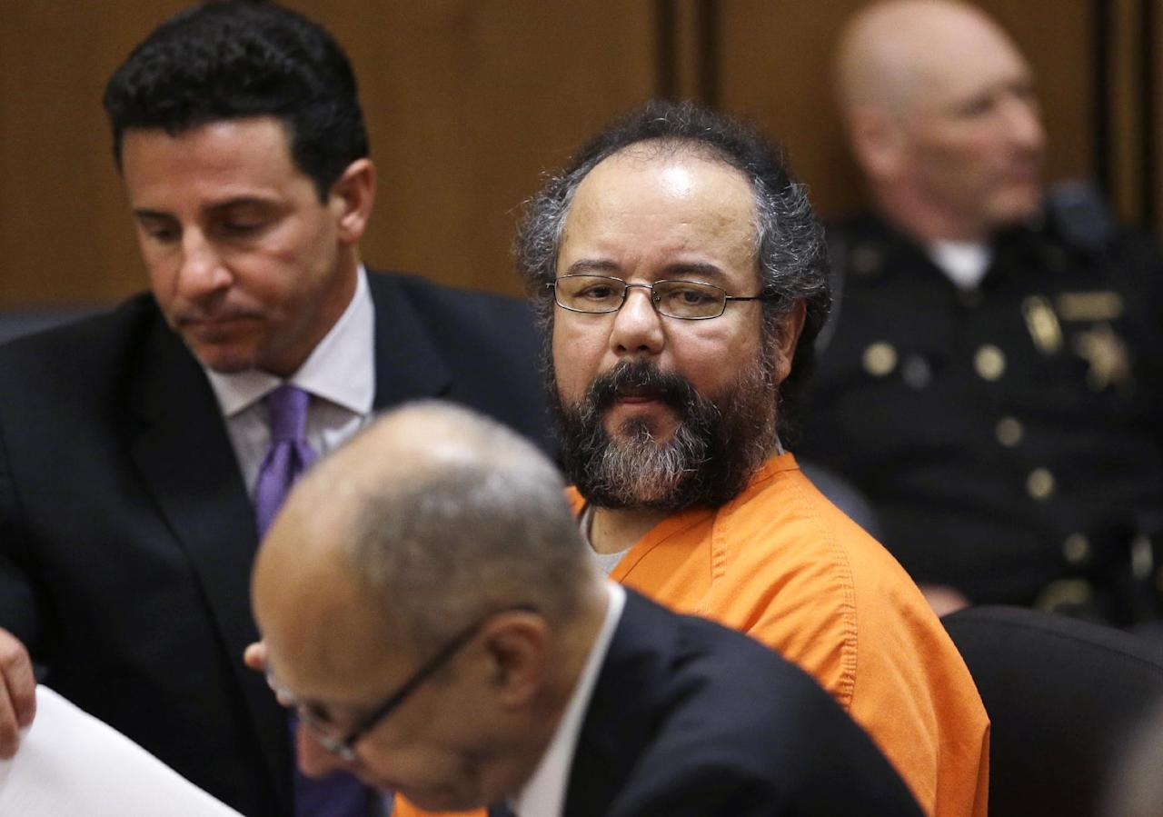 Ariel Castro looks over at the prosecutors table during court proceedings Friday, July 26, 2013, in Cleveland. Castro, who imprisoned three women in his home, subjecting them to a decade of rapes and beatings, pleaded guilty Friday to 937 counts in a deal to avoid the death penalty. In exchange, prosecutors recommended Castro be sentenced to life without parole plus 1,000 years. (AP Photo/Tony Dejak)