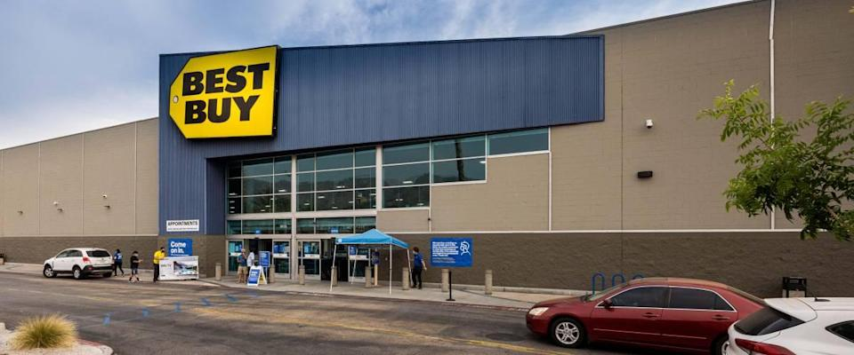 Best Buy store with cars driving past