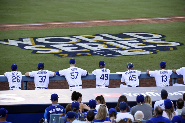 <p>Members of the Los Angeles Dodgers look on from the dugout during Game 1 of the 2017 World Series against the Houston Astros at Dodger Stadium on Tuesday, October 24, 2017 in Los Angeles, California. (Photo by LG Patterson/MLB Photos via Getty Images) </p>