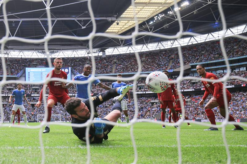 Raheem Sterling of Manchester City scores the opening goal of the game. (Credit: Getty Images)