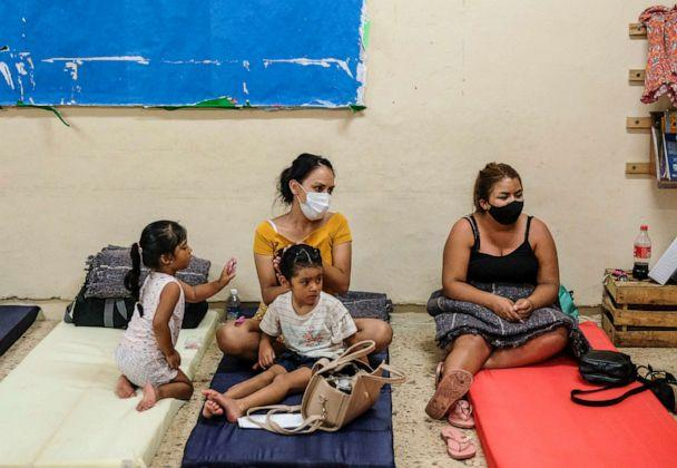 PHOTO: People rest in a shelter prior to the arrival of Hurricane Delta in Cancun, Mexico, Oct. 6, 2020. Delta rapidly intensified into a potentially catastrophic Category 4 hurricane on a course to hit Mexico and continue on to the U.S. Gulf coast.  (Victor Ruiz Garcia/AP)