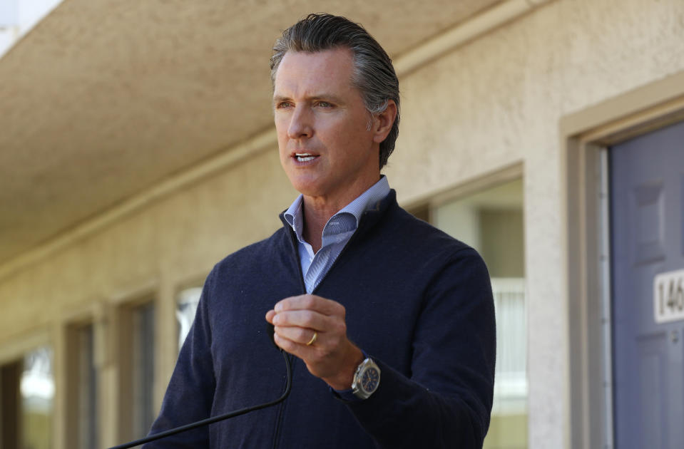 Gov. Gavin Newsom gives an update on the state's initiative to provide housing for homeless Californians to help stem the coronavirus in Pittsburg, Calif. on June 30, 2020. (Rich Pedroncelli/Pool via AP)