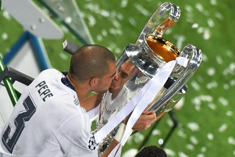 Defender Pepe kisses the trophy after Real Madrid won the UEFA Champions League final in Milan on May 28, 2016